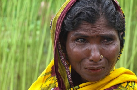 A woman weeps after Bangladesh and India officially exchanged the adversely possessed enclaves at Dashiarchhara in in Kurigram district is 240 kilometers (150 miles) north of Dhaka, Bangladesh's capital, Saturday, Aug. 1, 2015. Tens of thousands of stateless people who were stranded for decades along the poorly defined border between India and Bangladesh can finally choose their citizenship, as the two countries swapped more than 150 pockets of land at the stroke of midnight Friday to settle the demarcation line dividing them. (AP Photo/Zakir Hossain Chowdhury)