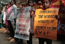 "Bangladeshi relatives of victims of the fire, that killed over a hundred workers, on Nov. 24, 2012 at Tazreen Fashions hold placards during a demonstration outside the factory on its second anniversary in Savar, on the outskirts of Dhaka, Bangladesh, Monday, Nov. 24, 2014. Garment factory workers, activists and relatives of the victims still protest demanding compensations for the survivors and a full account of the missing. Placard second right reads, ""Sumaya Khatun, a victim of Tazreen Fashions fire, - where is compensation?"" (AP Photo/A.M. Ahad)"
